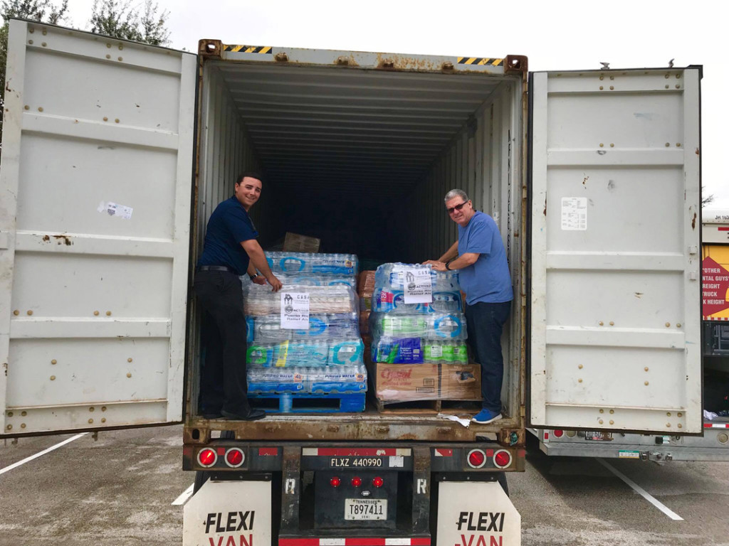 El Meson Sandwiches collect, transport and distribute emergency supplies for hurricane Maria victims in Puerto Rico.